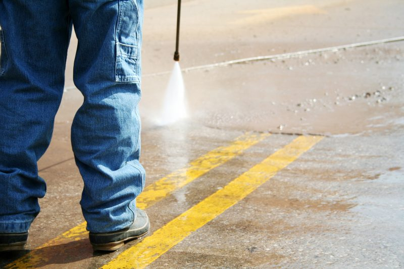 powerwashing the parking lot and cleaning the stripes